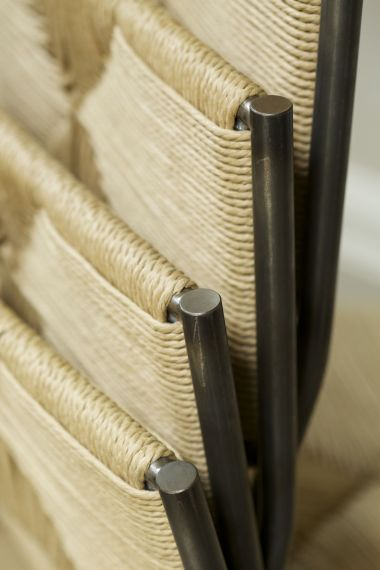 Stacked designer chairs by Rose Uniacke