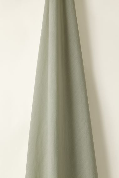 Luxury Light weight linen fabric in celadon for use on curtains and soft furnishings by Rose Uniacke.