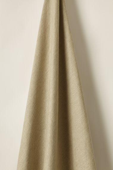 Hand printed luxury mid-weight linen fabric in biscuit by Rose Uniacke