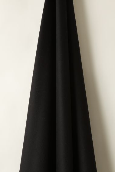 Wool fabric in Crow by Rose Uniacke