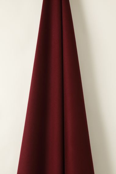 Luxury Wool fabric in garnet by Rose Uniacke