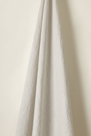 Designer Lightweight oyster coloured linen fabric by Rose Uniacke