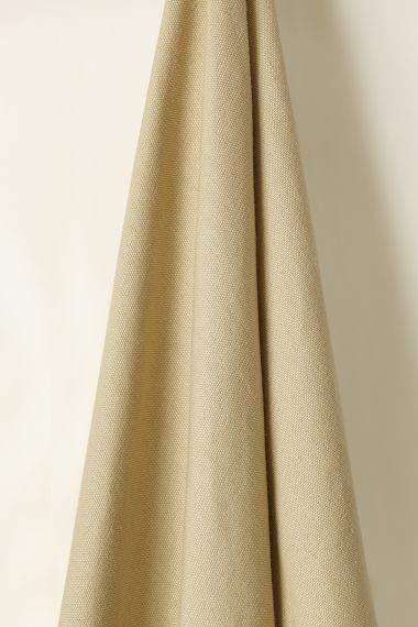 Designer Heavy weight linen fabric in fudge for use on upholstery by Rose Uniacke.