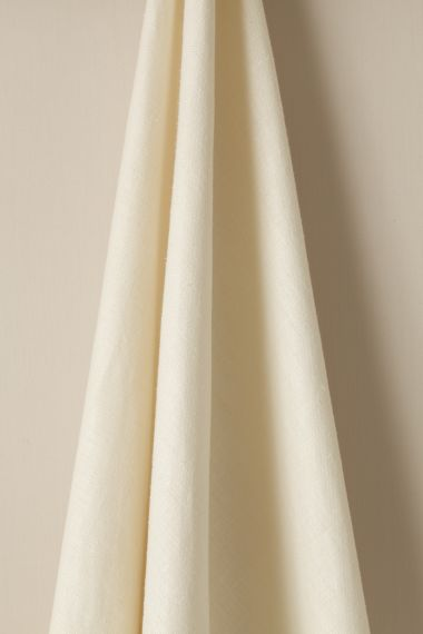 Designer Mid weight linen fabric in milk for use on curtains and soft furnishings by Rose Uniacke.