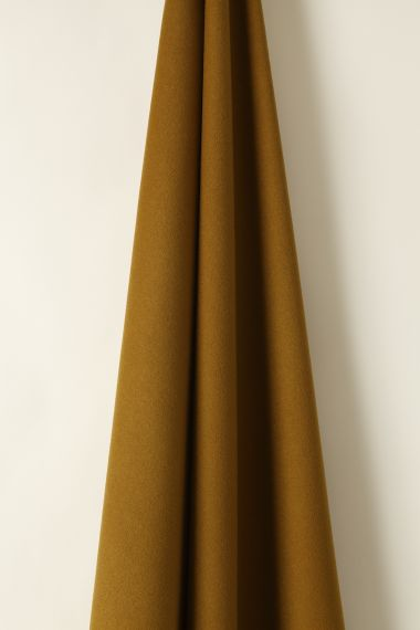 Wool fabric in Cumin colour by Rose Uniacke