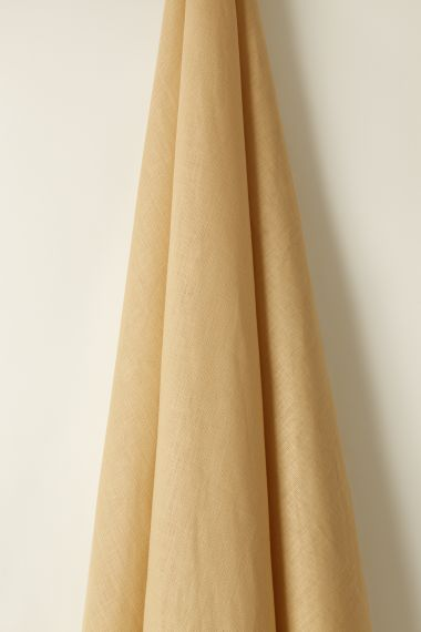 designer Light Weight Linen fabric in Clotted Cream by Rose Uniacke