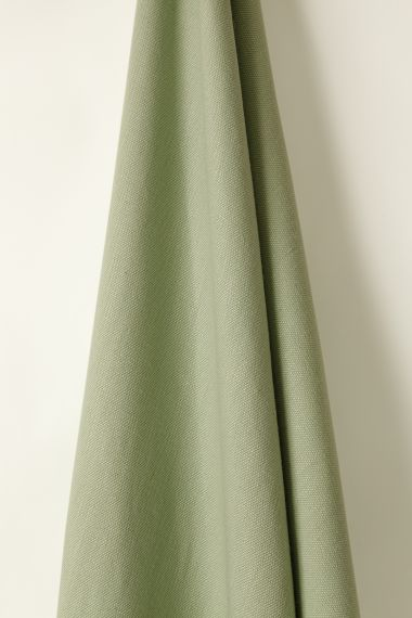 Heavy weight linen fabric in menthe green for use on upholstery by Rose Uniacke.