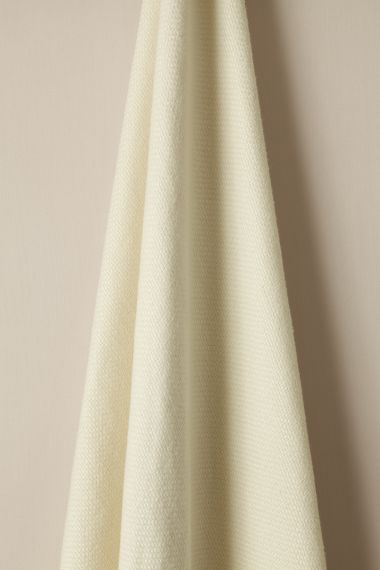 Designer Heavy weight linen fabric in daisy for use on upholstery by Rose Uniacke.