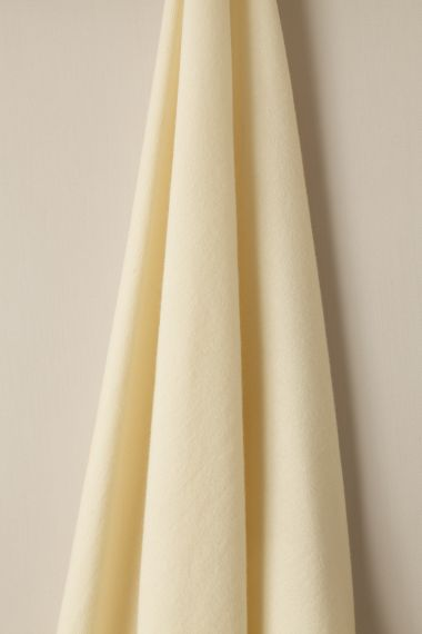 Wool fabric in Ricotta by Rose Uniacke