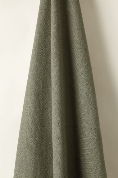 Heavy weight designer linen fabric in olive for use on upholstery, curtains and soft furnishings by Rose Uniacke