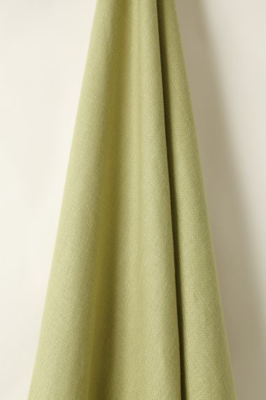 Designer Heavy weight linen fabric in green tea for use on upholstery by Rose Uniacke.