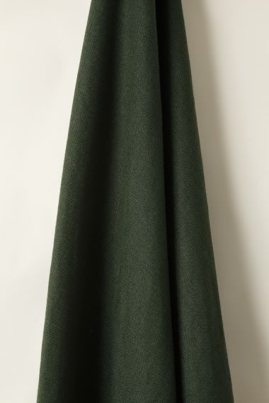 Designer Heavy weight linen fabric in evergreen for use on upholstery, curtains and soft furnishings by Rose Uniacke.