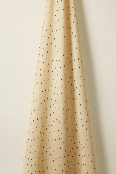 Luxury Sheer linen fabric in teal spot on honey by Rose Uniacke.