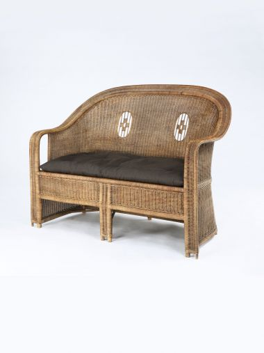 Light Weight Linen in Cinder by Rose Uniacke on wicker sofa