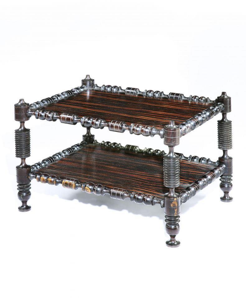 A mid 19th century ebony and calemander two tier occasional table_0