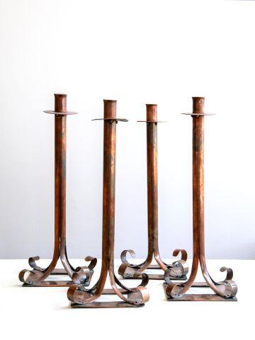 Set of Four Arts & Crafts Copper Candlesticks