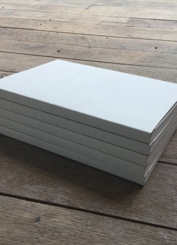 Pale grey embossed Swiss-bound notepad