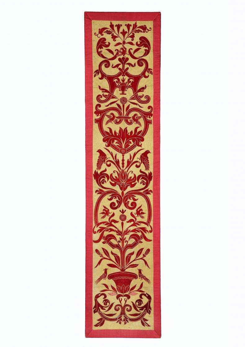 Antique panel of applique red velvet on a yellow silk ground