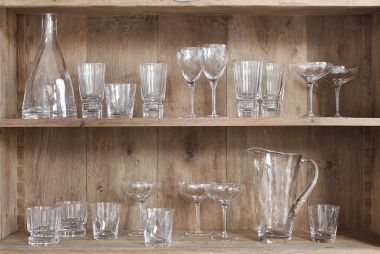 Champagne Coupe and glassware collection in wooden cupboard