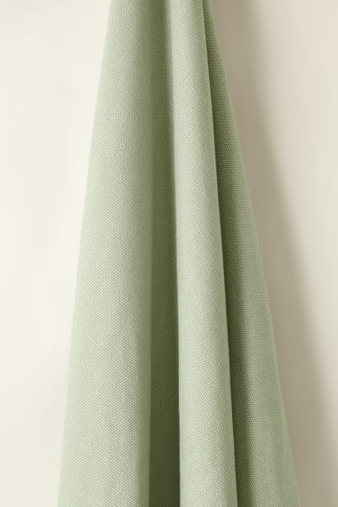 Designer Heavy weight linen fabric in wharf for use on upholstery by Rose Uniacke