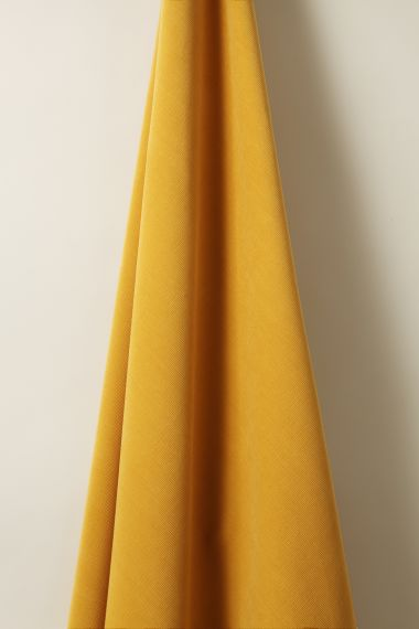 Designer Corduroy fabric in Butterscotch by Rose Uniacke