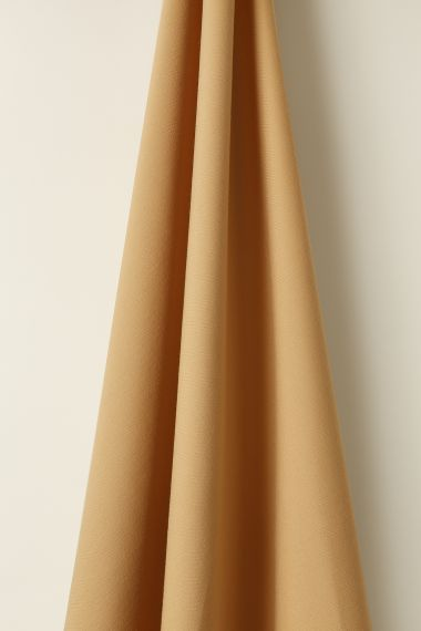 Luxury Wool fabric in Beeswax by Rose Uniacke